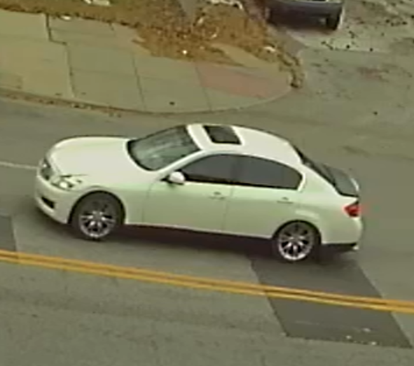 Police are trying to identify the owner or occupants of the pictured white Infinity with a black trunk lid.