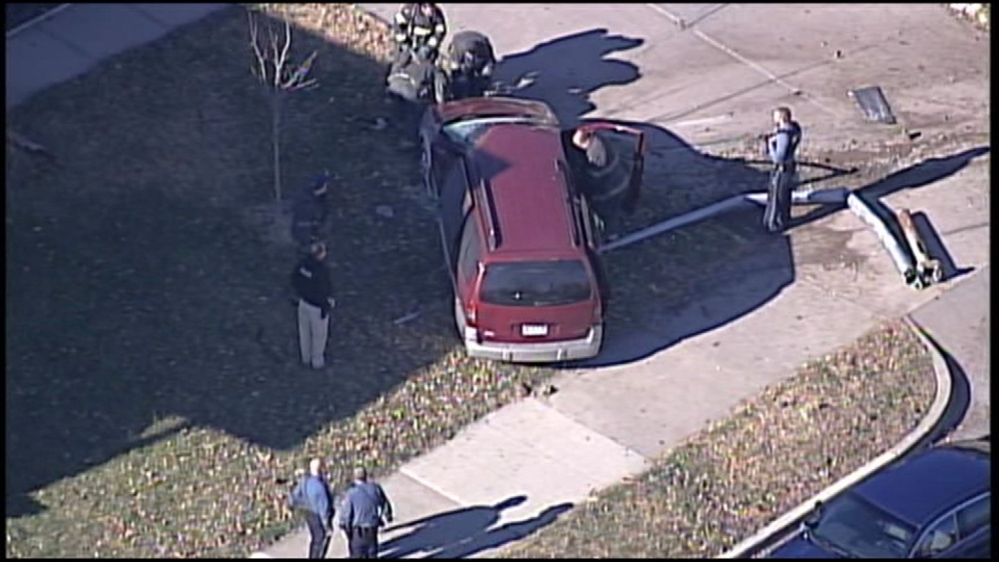 The chase ended about 1:15 p.m. at 44th Street and The Paseo after the vehicle went over a curb, hit a light pole and ended up in someone's front yard. (Chopper5)