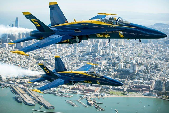 In advance of Fleet Week performances, U.S. Navy Blue Angels fly over the San Francisco Bay during a photo flight on Thursday, Oct. 5, 2017. (AP Photo/Noah Berger)