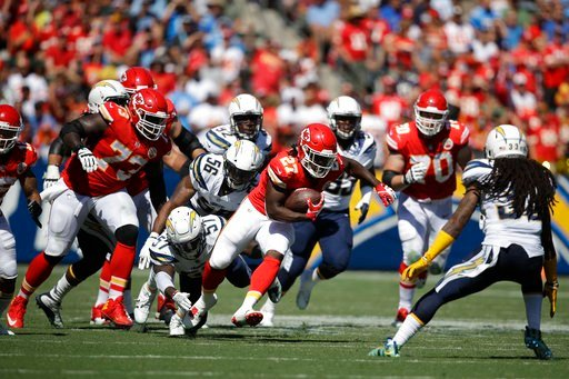 Kansas City Chiefs' Kareem Hunt carries the ball during an NFL football game against the Los Angeles Chargers, Sunday, Sept. 24, 2017, in Carson, Calif. (AP Photo/Jae C. Hong)