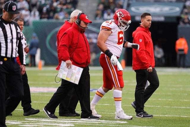Kansas City Chiefs' Mitch Morse, center, is walked off the field during the first half of an NFL football game against the New York Jets, Sunday, Dec. 3, 2017, in East Rutherford, N.J. (AP Photo/Julie Jacobson)