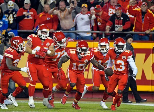 Kansas City Chiefs wide receiver Tyreek Hill (10) celebrates his touchdown against the Los Angeles Chargers with teammates during the first half of an NFL football game in Kansas City, Mo., Saturday, Dec. 16, 2017. (AP Photo/Ed Zurga)