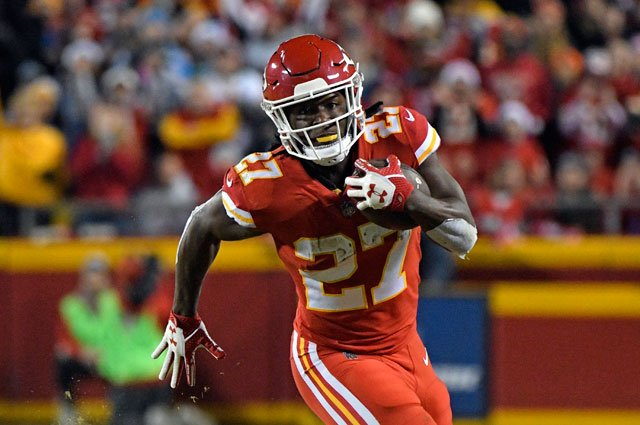 Kansas City Chiefs running back Kareem Hunt (27) carries the ball during the first half of an NFL football game against the Los Angeles Chargers in Kansas City, Mo., Saturday, Dec. 16, 2017. (AP Photo/Ed Zurga)