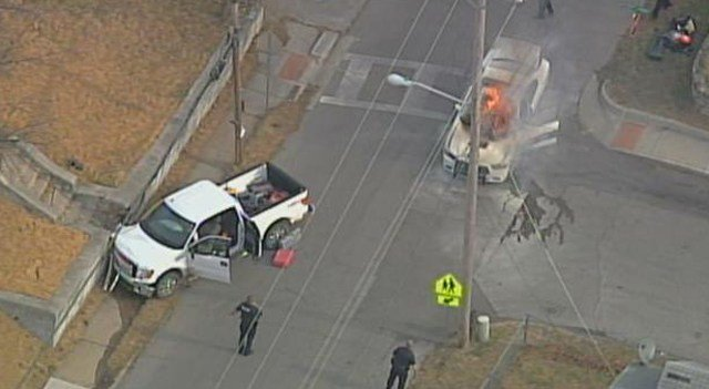 A white pick-up truck was crashed at the scene. (KCTV5)