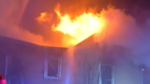 The flames started before 4:10 a.m. at a house in the 8200 block of Brooklyn Avenue. (KCTV5)