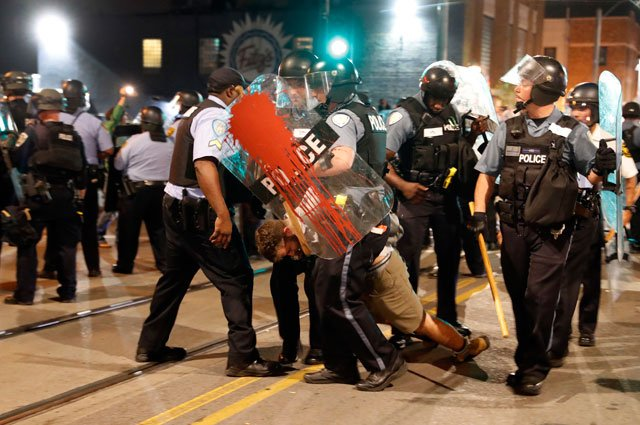 Police arrest a man as they try to clear a violent crowd Saturday, Sept. 16, 2017, in University City, Mo. Earlier, protesters marched peacefully in response to a not guilty verdict in the trial of former St. Louis police officer Jason Stockley. (AP)