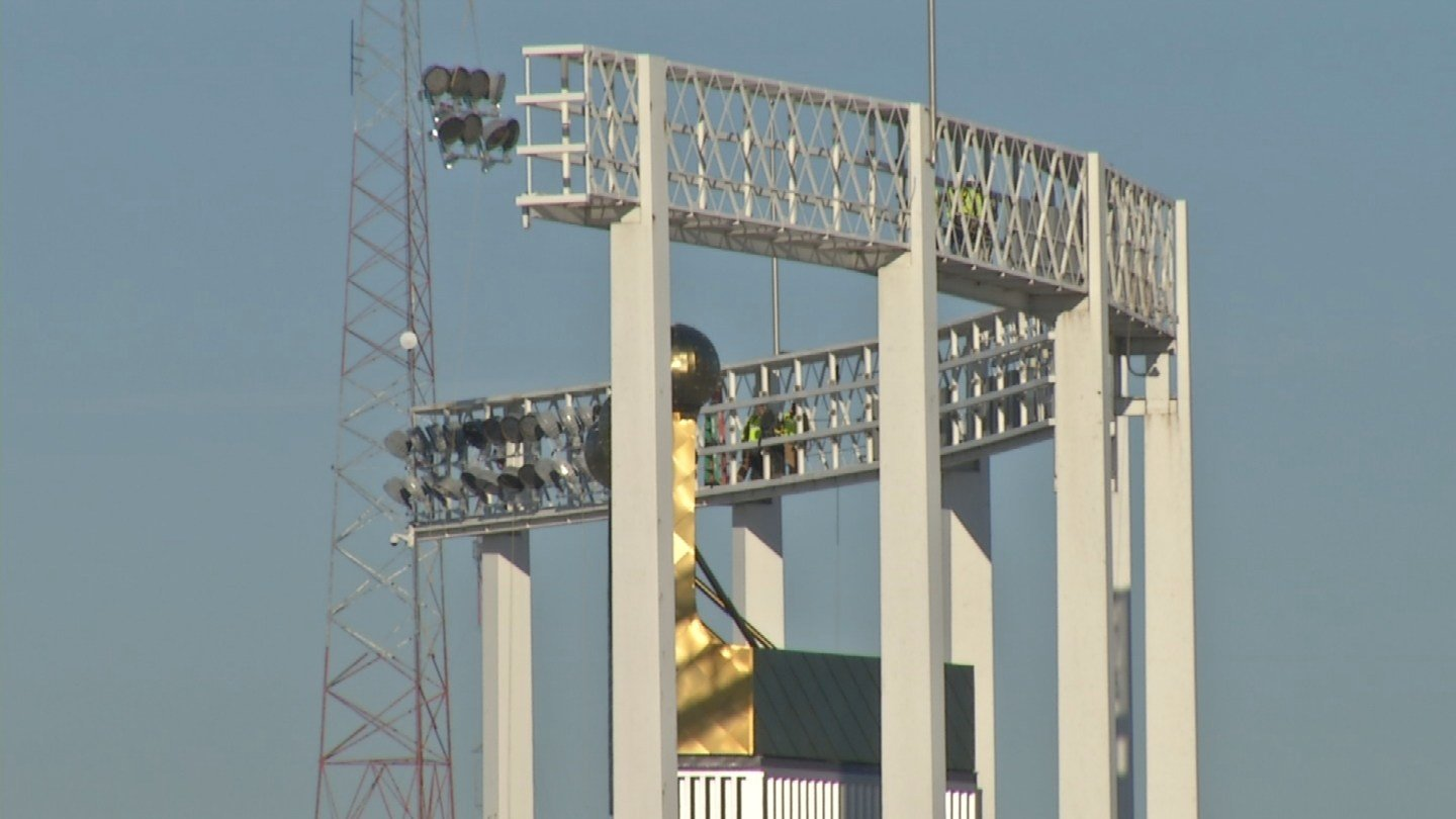Crews used a helicopter to put 412 LED lights in place one-by-one at Kauffman Stadium on Wednesday. (KCTV5)