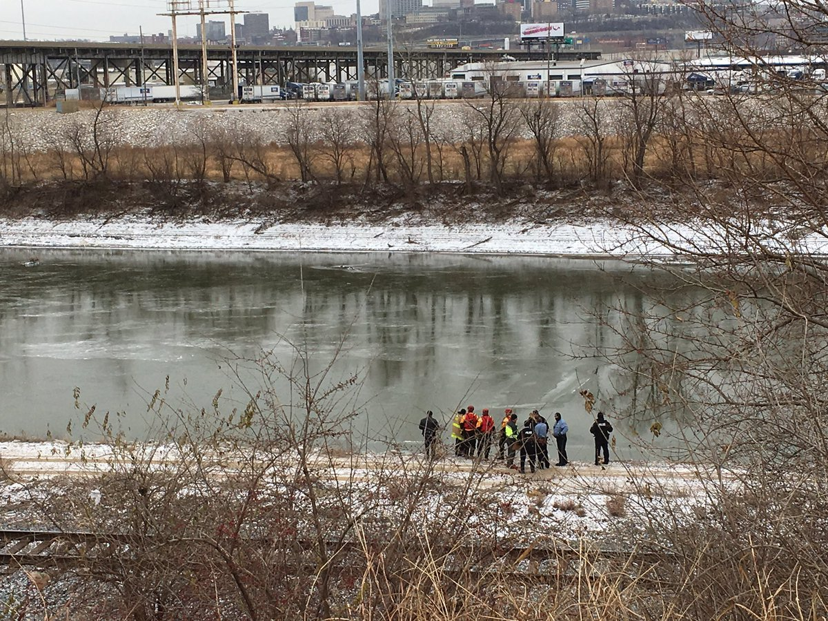 A city water pollution employee discovered the body, which was partially in the water, around 10 a.m. on an access road near N Third and James Streets. (Ashley Arnold/KCTV)