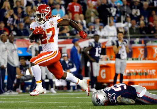 Kansas City Chiefs running back Kareem Hunt (27) eludes New England Patriots defensive end Cassius Marsh (55) as he runs for a touchdown after catching a pass from Alex Smith during the second half on Sept. 7, 2017. (AP Photo/Steven Senne)