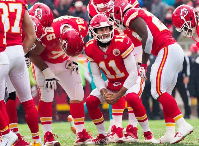 Kansas City Chiefs quarterback Alex Smith (11) with his team during the first half of an NFL football game against the Miami Dolphins in Kansas City, Mo., Sunday, Dec. 24, 2017. (AP Photo/Reed Hoffmann)