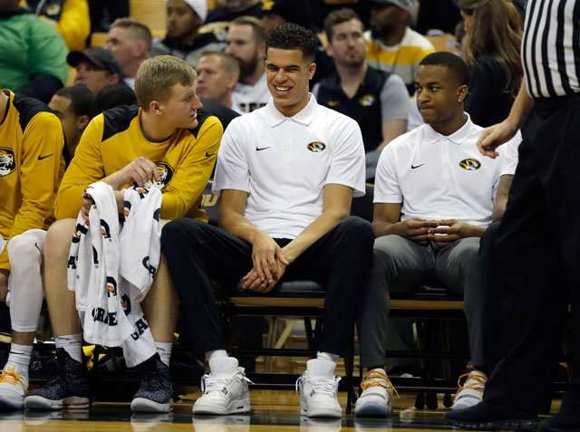 Missouri forward Michael Porter Jr. smiles as he sits on the bench during the first half of an NCAA college basketball game against Miami (Ohio) Tuesday, Dec. 5, 2017, in Columbia, Mo. Porter is recuperating after a recent back surgery. (AP)