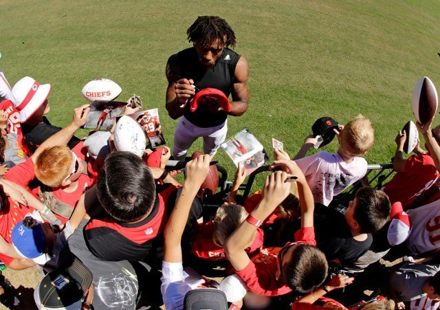 Kansas City Chiefs strong safety Eric Berry signs autographs at NFL football training camp Friday, Aug. 4, 2017, in St. Joseph, Mo. (AP Photo/Charlie Riedel)