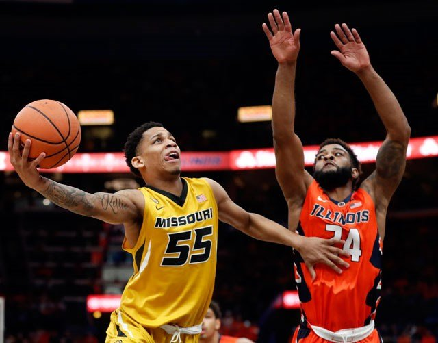 Missouri's Blake Harris (55) heads to the basket as Illinois' Mark Alstork defends during the second half of an NCAA college basketball game Saturday, Dec. 23, 2017, in St. Louis. Illinois won 70-64. (AP Photo/Jeff Roberson)