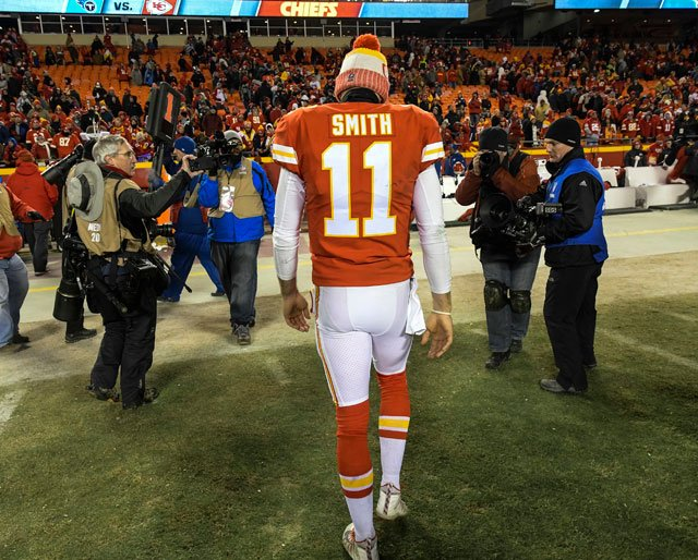 Kansas City Chiefs quarterback Alex Smith (11) leaves the field after losing to the Tennessee Titans in an NFL wild-card playoff game in Kansas City, Mo., Saturday, Jan. 6, 2018. (AP Photo/Reed Hoffmann)