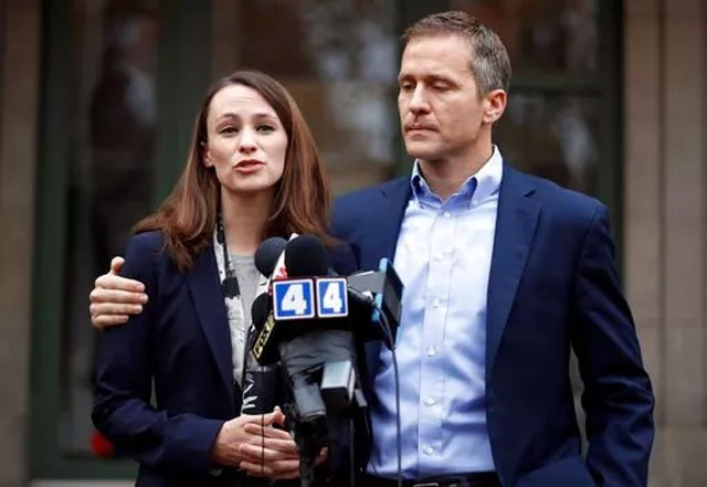 (AP Photo/Jeff Roberson, File). FILE - In this Dec. 6, 2016, file photo, Missouri Gov.-elect Eric Greitens and his wife Sheena speak to the media in St. Louis after she had been robbed at gunpoint the day before.