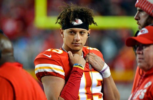 Kansas City Chiefs quarterback Patrick Mahomes (15) stands with teammates during the first half of an NFL football game against the Los Angeles Chargers in Kansas City, Mo., Saturday, Dec. 16, 2017. (AP Photo/Ed Zurga)