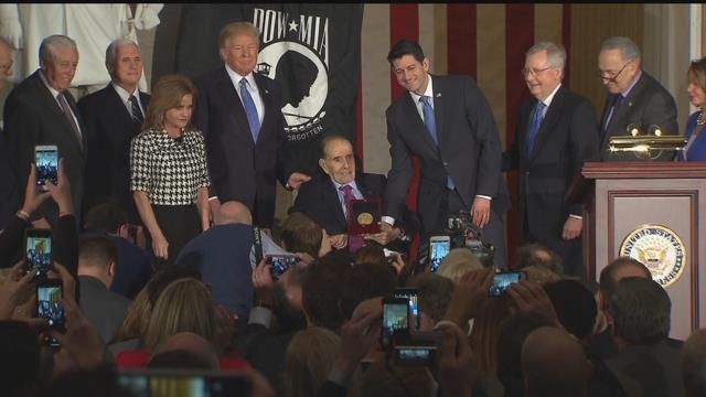 Former Senate Majority LeaderBobDolereceived the Congressional Gold Medal on Wednesday. (CBS)