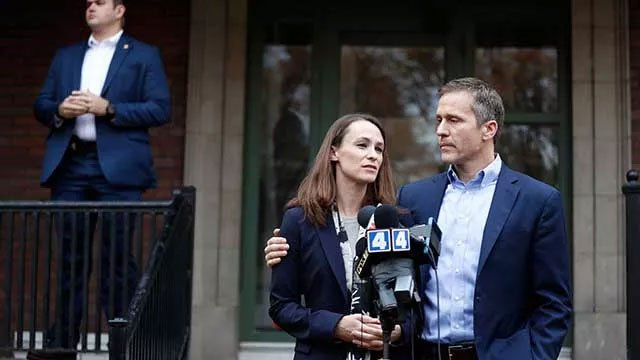 Missouri Gov.-elect Eric Greitens, right, and his wife Sheena speak to the media as a member of their protection detail stands off to the side Tuesday, Dec. 6, 2016, in St. Louis.(AP Photo/Jeff Roberson)