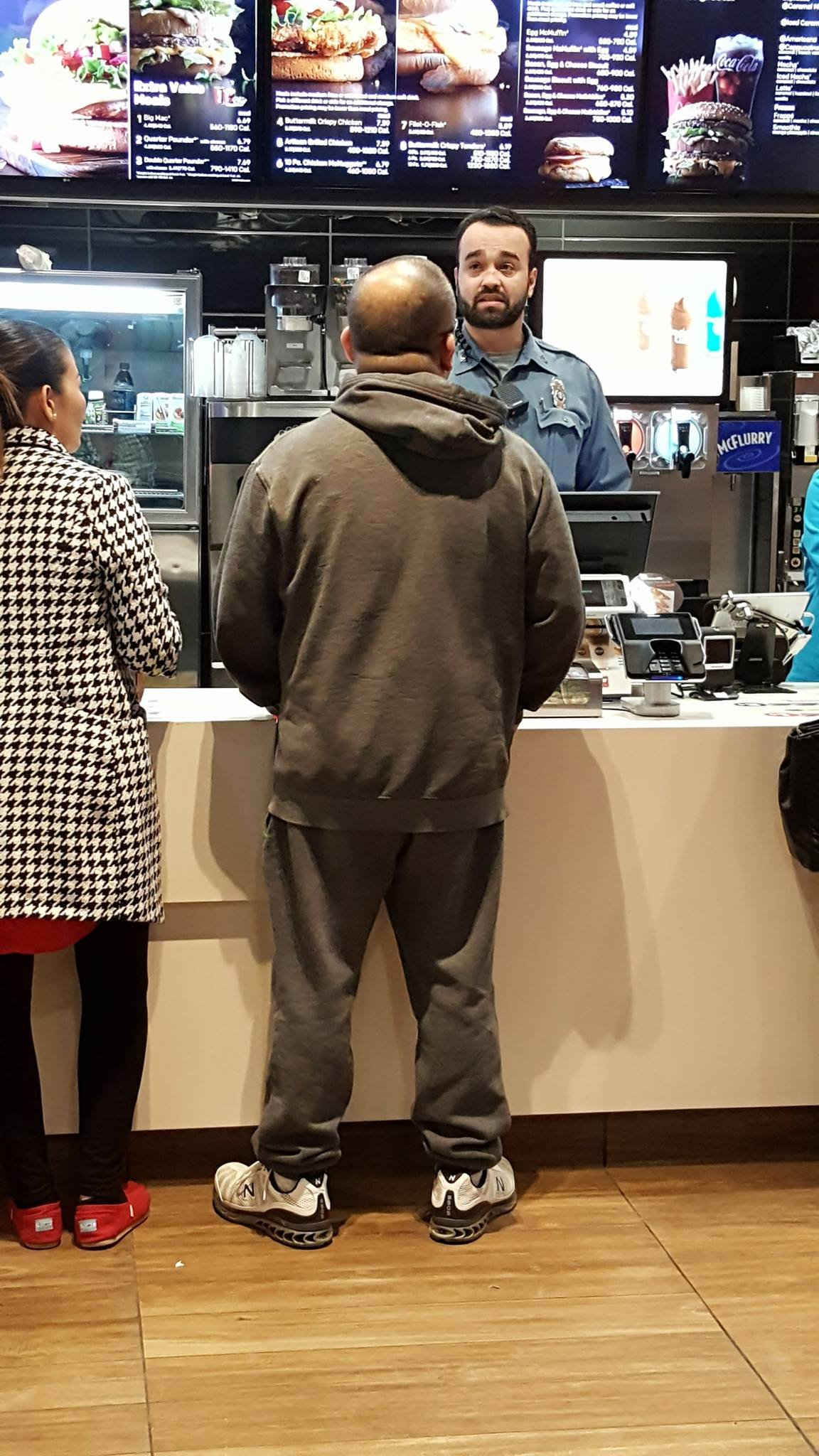 A photo of an off-duty Kansas City police officer taking orders at a local McDonald's has gone viral. (Kansas City Police Department)