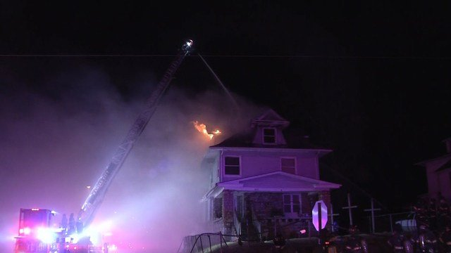 Firefighters had to rescue a man from a window on the second story of the home. (KCTV5)