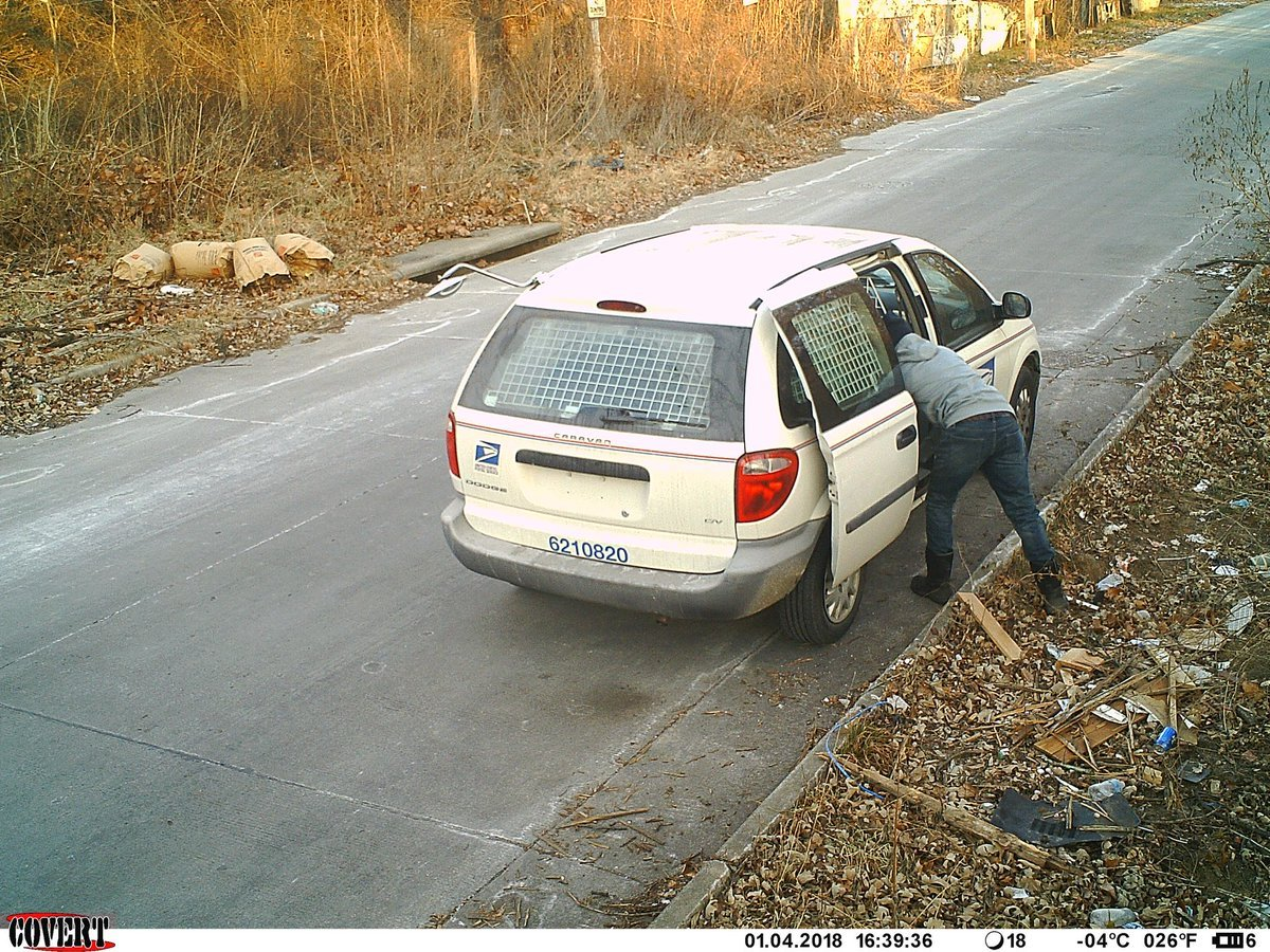 Cameras at the corner of 45th Street and Garfield Avenue captured a mail carrier taking a break on the side of the road Thursday. (KCMO)