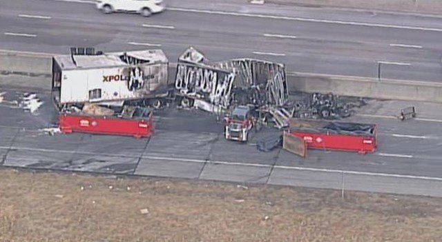 Officials do not know what caused the wreck but say the truck was hauling an XPO Logistics trailer carrying a corrosive substance. (KCTV5)