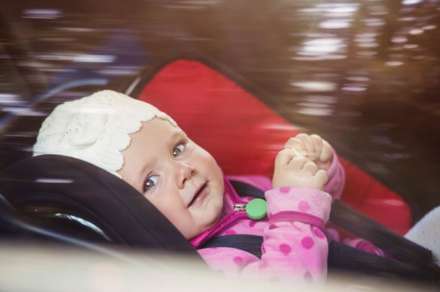 A Kansas City lawmaker wants to increase the time your child spends in a rear-facing car seat. (Graphicstock)