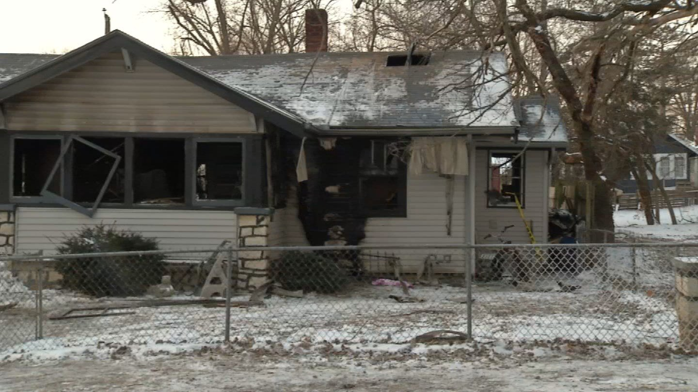 Police are looking into what caused a person's death after a body was found inside a burning home early Monday morning. (KCTV5)