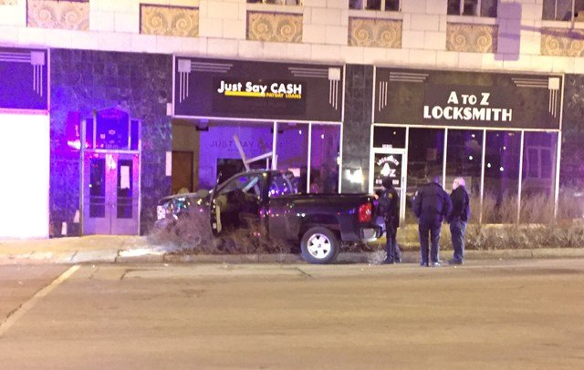 Officers took the driver into custody and took him to an area hospital with minor injuries. (KCTV5)