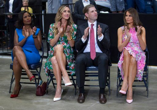 Omarosa Manigault, Eric Trump, Lara Trump, and Melania Trump sit to the side of the stage as President Donald Trump speaks during a Make America Great Again rally, July 25, 2017, at the Covelli Centre in Youngstown, Ohio. (AP Photo/Carolyn Kaster)