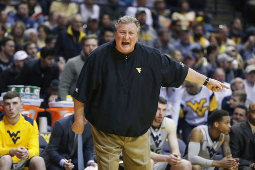 FILE - In this Monday, Jan. 15, 2018, file photo, West Virginia head coach Bob Huggins screams directions to his players during the first half of an NCAA college basketball game against Kansas in Morgantown, W.Va. (AP Photo/Raymond Thompson, File)