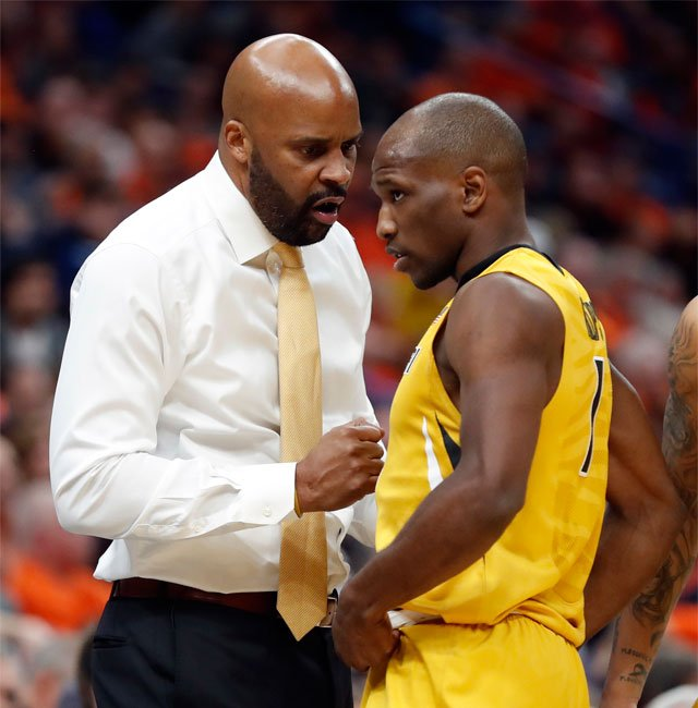 Missouri head coach Cuonzo Martin, left, talks with Terrence Phillips during the second half of an NCAA college basketball game against Illinois Saturday, Dec. 23, 2017, in St. Louis. Illinois won 70-64. (AP Photo/Jeff Roberson)