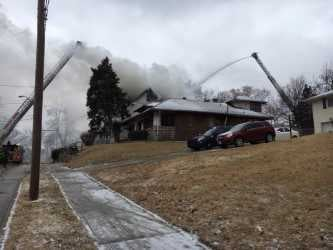 Kansas City firefighters are battling flames and freezing temperatures after a house caught fire near 27th and Grove streets. (Rob Rhodes/KCTV5)