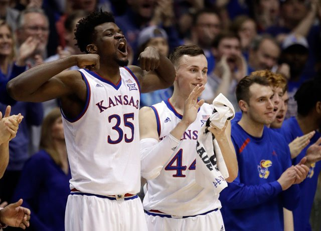 Kansas center Udoka Azubuike (35) and Kansas forward Mitch Lightfoot (44) celebrate a basket from the bench during the second half of an NCAA college basketball game against Oklahoma in Lawrence, Kan., Monday, Feb. 19, 2018. (AP)