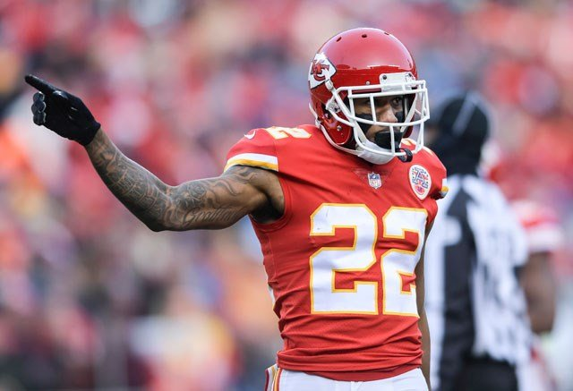 Kansas City Chiefs cornerback Marcus Peters (22) signals to the bench that a penalty is against the Tennessee Titans during the first half of an NFL wild-card playoff game in Kansas City, Mo., Saturday, Jan. 6, 2018. (AP Photo/Reed Hoffmann)