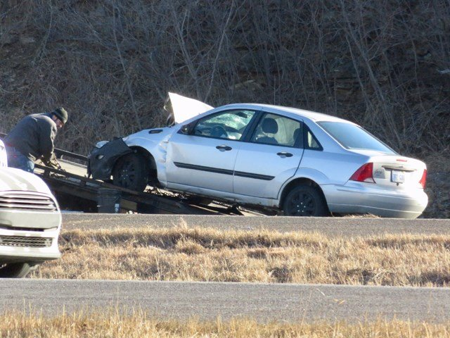 A silver Ford Focus, a red Ford F-150 and a maroon sedan were involved in the accident. (KCTV5)