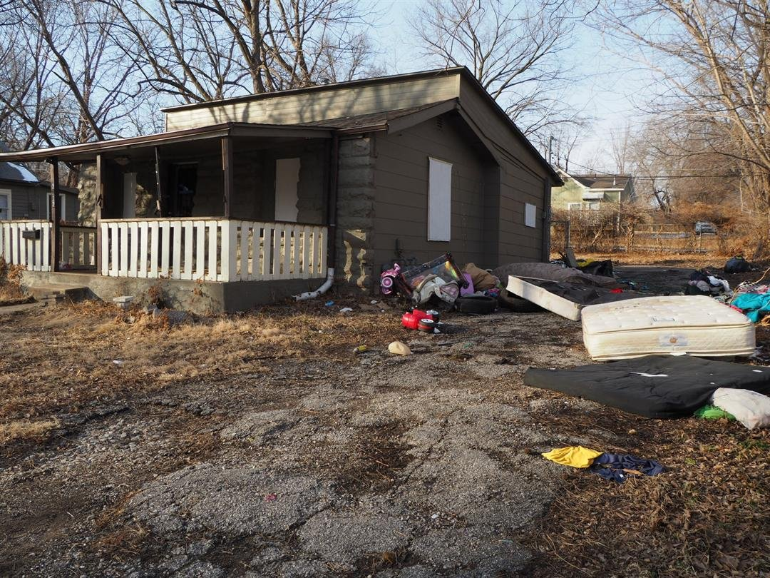 This is a vacant Raineth home that has turned into a dumping ground. (KCTV5)