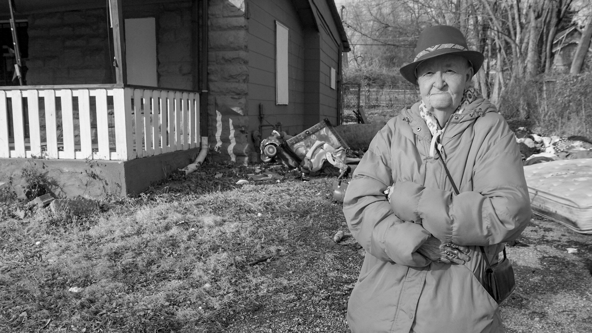Roberta Dayberry stands outside the neighborhood eyesore owned by Raineth of 82nd Terrace. (KCTV5)