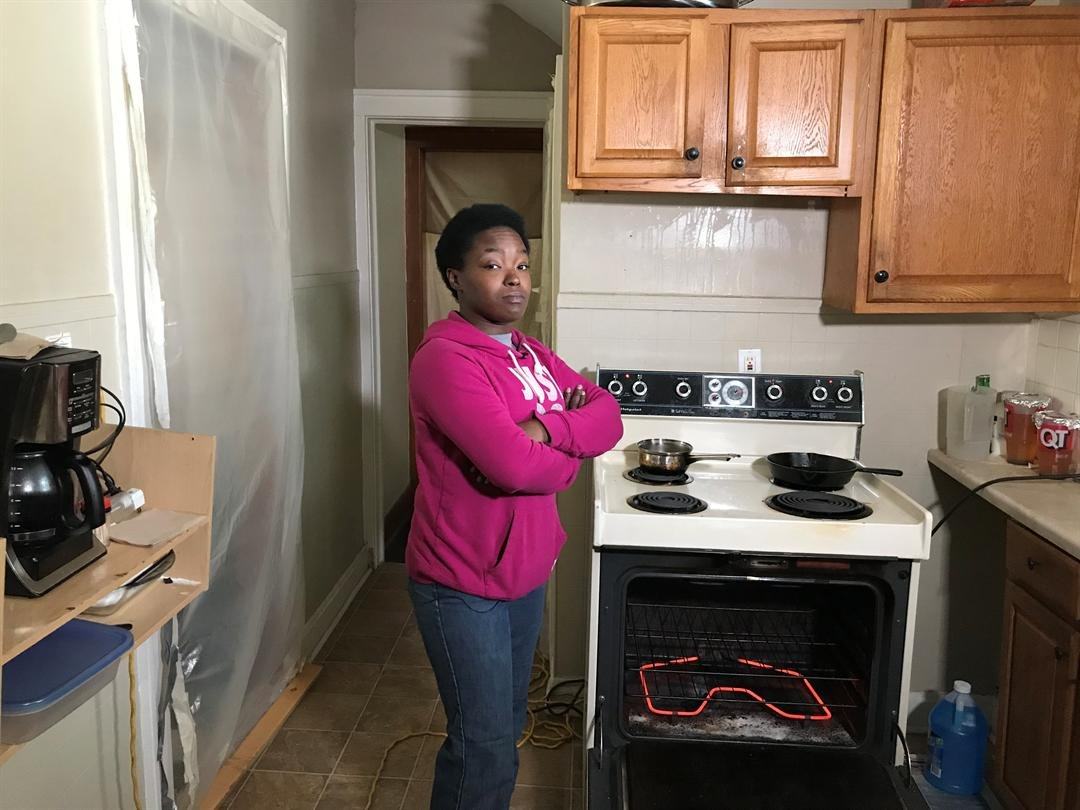 Sherrie Johnson stands in front of her oven, using it to heat her home. (KCTV5)