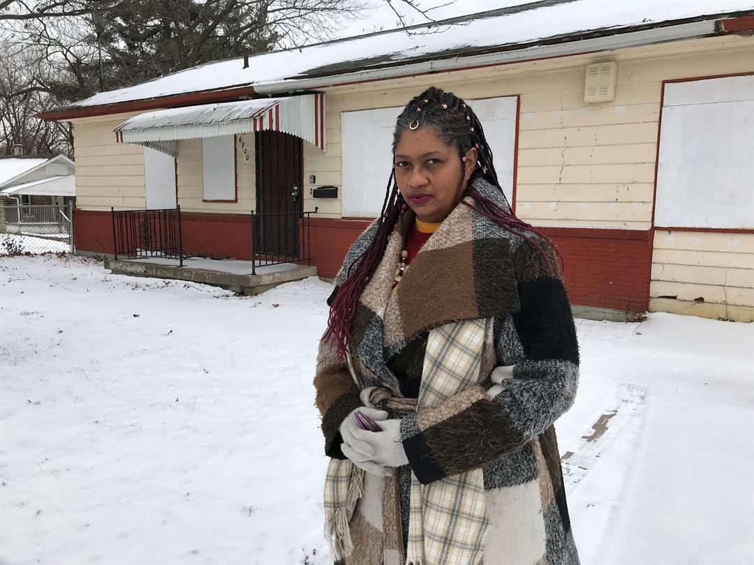 Voncelle Dawson stands outside the home where she was evicted near 68th, Bales. (KCTV5)