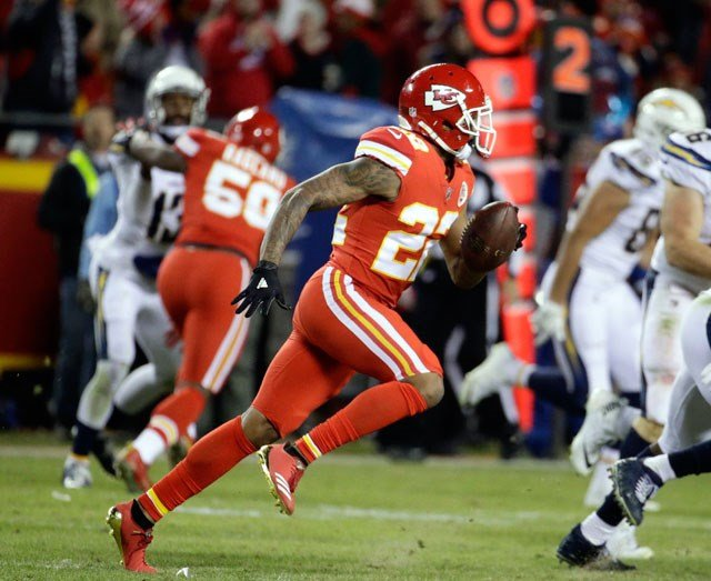 Kansas City Chiefs defensive back Marcus Peters (22) runs for 62-yards after intercepting the ball during the second half of an NFL football game against the Kansas City Chiefs in Kansas City, Mo., Saturday, Dec. 16, 2017. (AP Photo/Charlie Riedel)