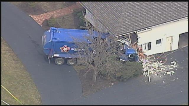 The driver of a garbage truck suffered critical injuries after crashing into a Prairie Village home. (Chopper5)