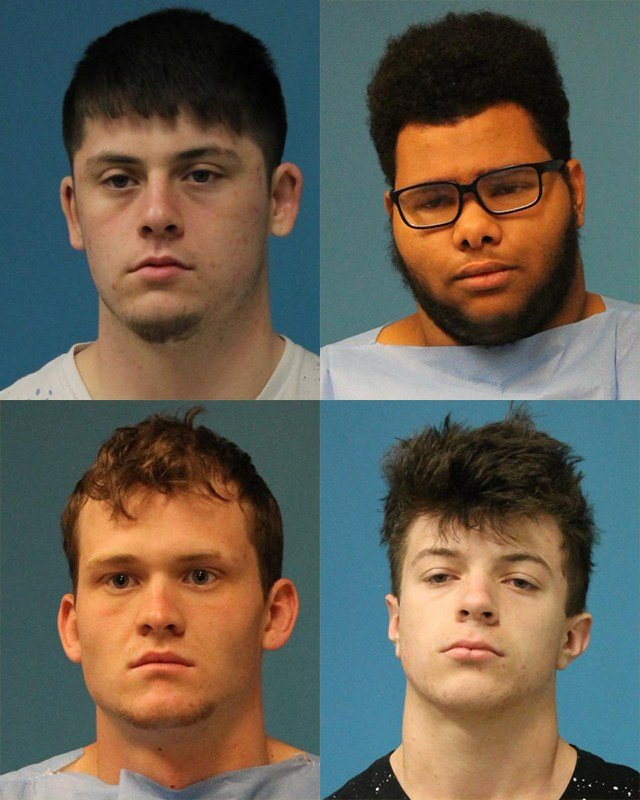 Court documents state the four defendants were seen in the parking lot at the high school.(Lee's Summit PD)