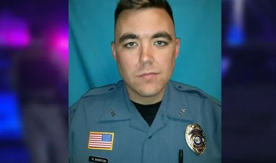 Christopher Ryan Morton and two other officers were wounded Tuesday after they were sent to the wrong house while responding to a 911 call made from another town. (KCTV5)
