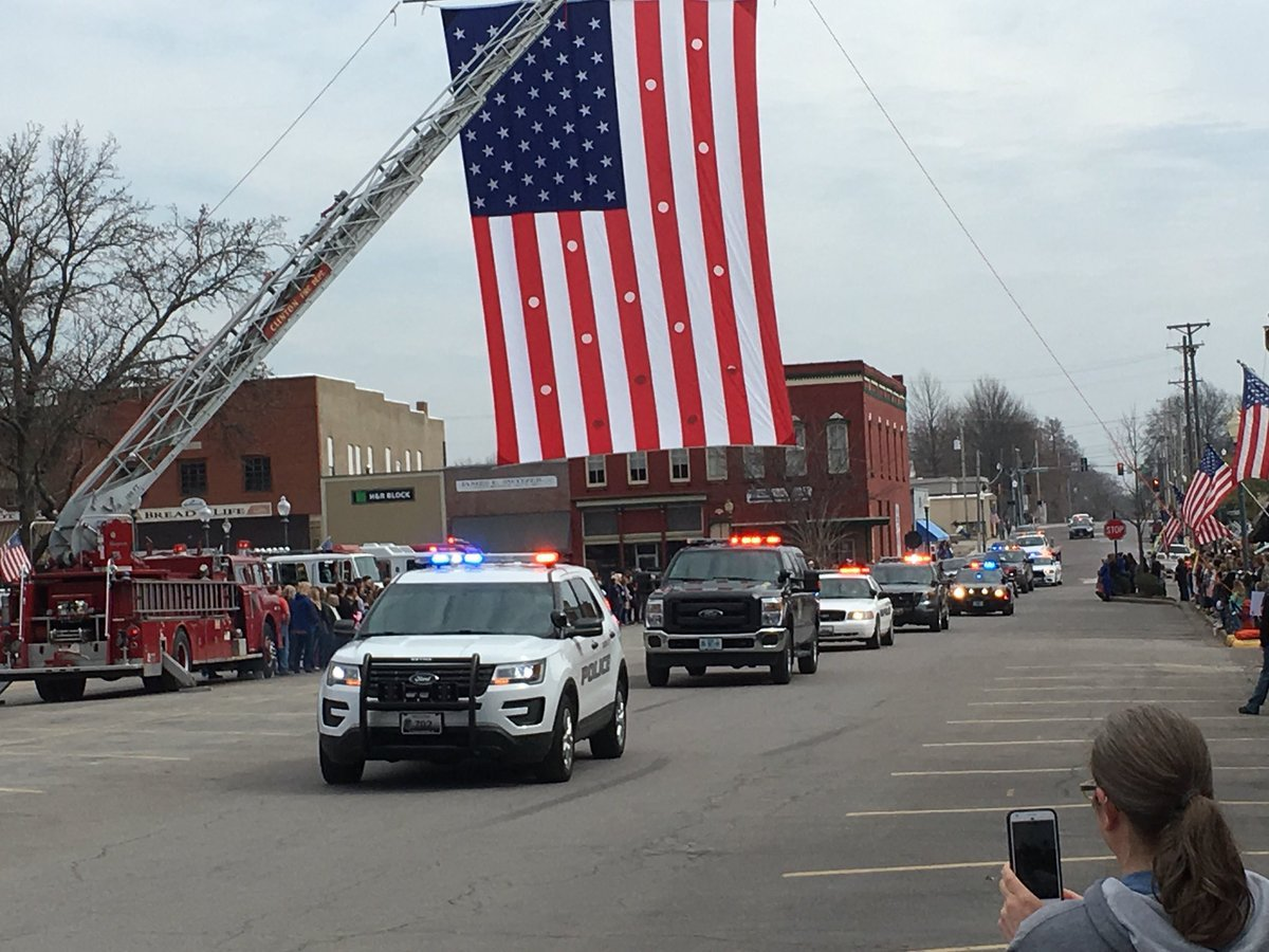 The body of slain Clinton police officer Christopher Ryan Morton was escorted from Kansas City to Clinton on Friday. (Ashley Arnold/KCTV5 News)