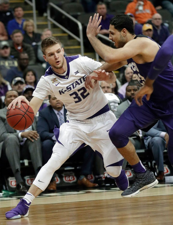 K-State forward Dean Wade looks for room around TCU forward Ahmed Hamdy-Mohamed during the first half of an NCAA college basketball game in quarterfinals of the Big 12 men's tournament in Kansas City, Mo., Thursday, March 8, 2018. (AP Photo/Orlin Wagner)