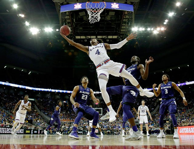 Kansas' Devonte' Graham puts up a shot during the second half of an NCAA college basketball game against Kansas State in the semifinals of the Big 12 conference tournament in Kansas City, Mo., Friday, March 9, 2018. Kansas won 83-67. (AP)