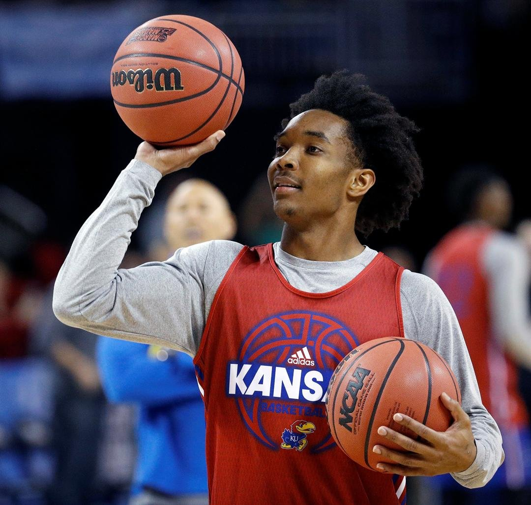 Kansas guard Devonte' Graham (4) practices for an NCAA college basketball first round game Wednesday, March 14, 2018, in Wichita, Kan. (AP Photo/Charlie Riedel)