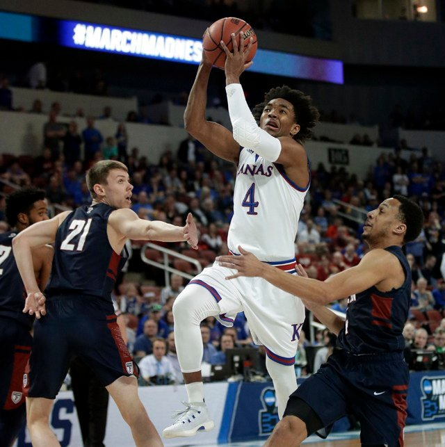 Devonte Graham ignited sluggish Kansas midway through the first half, pouring in 29 points and lifting the top-seeded Jayhawks to a tough, grind-it-out 76-60 victory. (AP)