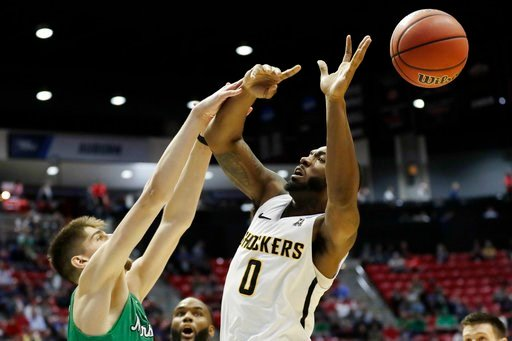 Marshall forward Ajdin Penava, left, blocks a shot by Wichita State forward Rashard Kelly (0), right, during the first half of an NCAA college basketball tournament first-round game Friday, March 16, 2018, in San Diego. (AP Photo/Gregory Bull)